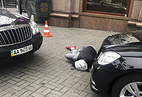 A killer, who shot and killed Denis Voronenkov, lies wounded in Kiev, Ukraine