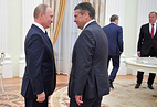 Russia's President Vladimir Putin and Germany's Minister of Foreign Affairs Sigmar Gabriel