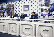 VTB's First Deputy President, Chairman of the Management Board Vasily Titov (left), TASS's Director General Sergei Mikhailov (center) and TASS's reporter Alexei Litvyakov (right) at a news conference, devoted to end of the TASS-VTB Bank project to digitize the agency's historic archive of photographs