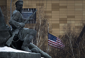 US Embassy seen behind a monument to the Workers of 1905 Revolution in Moscow