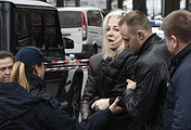 Maria Maksakova is assisted from the place where her husband Denis Voronenkov was killed, in Kiev, Ukraine