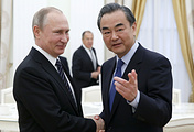 Russia's President Vladimir Putin and China's Foreign Minister Wang Yi