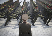 North Korean soldiers goose-step across Kim Il Sung Square in Pyongyang