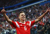 Russia's Denis Cheryshev celebrates scoring in the 2018 FIFA World Cup Group A Round 2 football match against Egypt at St Petersburg Stadium