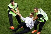 Stewards pull away Pyotr Verzilov, who broke into the pitch during the 2018 FIFA World Cup final