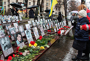 Kiev residents lay flowers at the Heavenly Hundred Memorial honoring those killed in the February 2014 clashes in Kiev's Independence Square