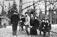 Emperor Nicholas II with his children, attendant and nanny during their walk in Tsarskoye Selo (former Russian residence of the imperial family near Saint Petersburg), 1907