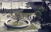 Students from the Marjory Stoneman Douglas High School in Parkland evacuate the school following a shooting