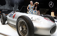 Models poses at the Mercedes-Benz W154 Grand Prix racing car at the 'Techno Classica' fair for classic and vintage cars in Essen, Germany