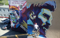 Murals depicting Portuguese footballer Cristiano Ronaldo and Argentinian footballer Lionel Messi in Kazan