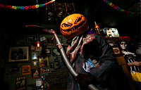 A person wearing a carved pumpkin during Halloween celebrations, Ryazan, October 27