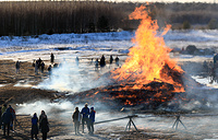 Bastille, a 20-metre-high art object, going down in flames during a celebration of Maslenitsa festival, or Pancake Week, at the Nikola-Lenivets Art Park, March 9