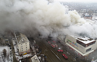 Smoke is seen above a multi-story shopping center in the Siberian city of Kemerovo, March 25, 2018