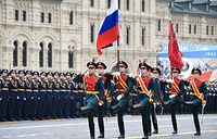 Honour guard of the Preobrazhensky Regiment with Russian national flag and Victory Banner