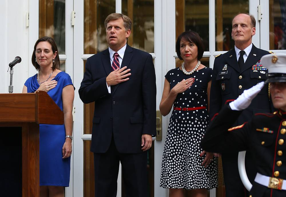 Michael McFaul (second left), with wife Donna (second right) stand to the national anthem at a reception to celebrate the US Independence Day