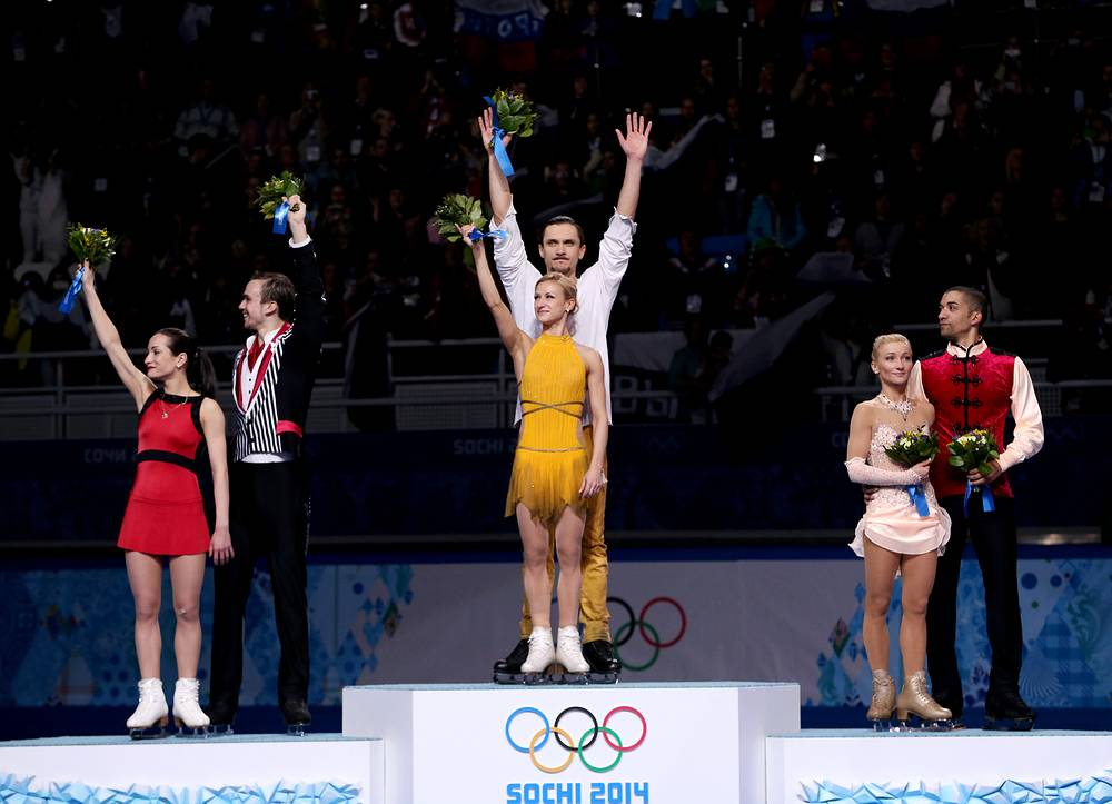 Gold medalists Tatiana Volosozhar and Maxim Trankov of Russia (C) flanked by Ksenia Stolbova and Fedor Klimov of Russia (L) and bronze medalists Aliona Savchenko and Robin Szolkowy of Germany