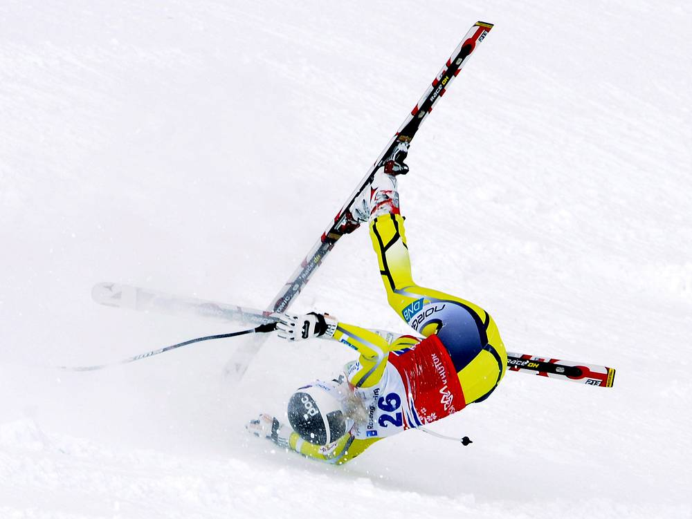 Lotte Smiseth Sjersted of Norway falls during the women's Downhill