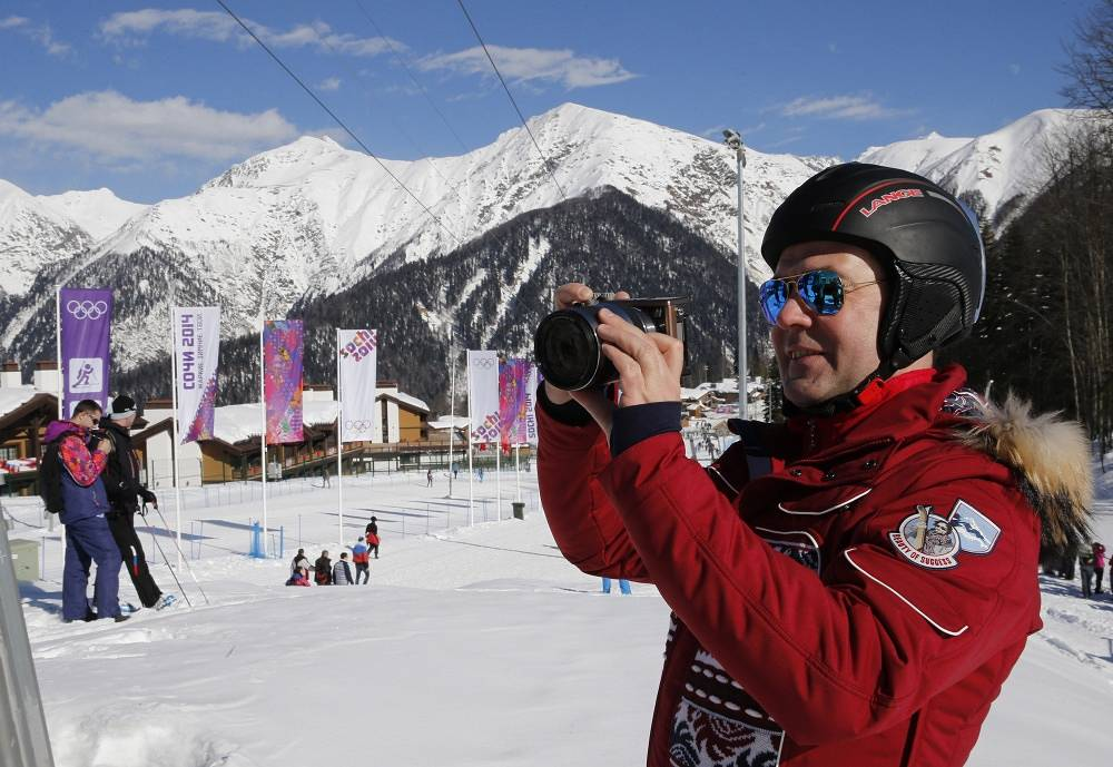 Russian Prime Minister Dmitry Medvedev takes photos in Roza Khutor Extreme Park