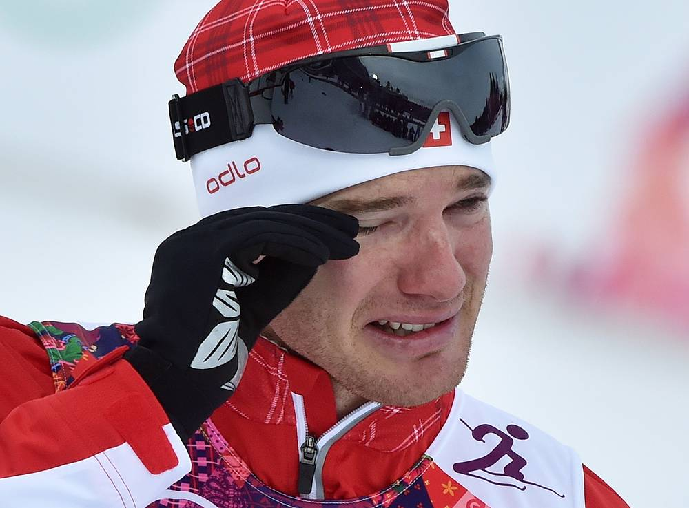 Dario Cologna of Switzerland cries after winning the Men's 15km + 15km Skiathlon competition