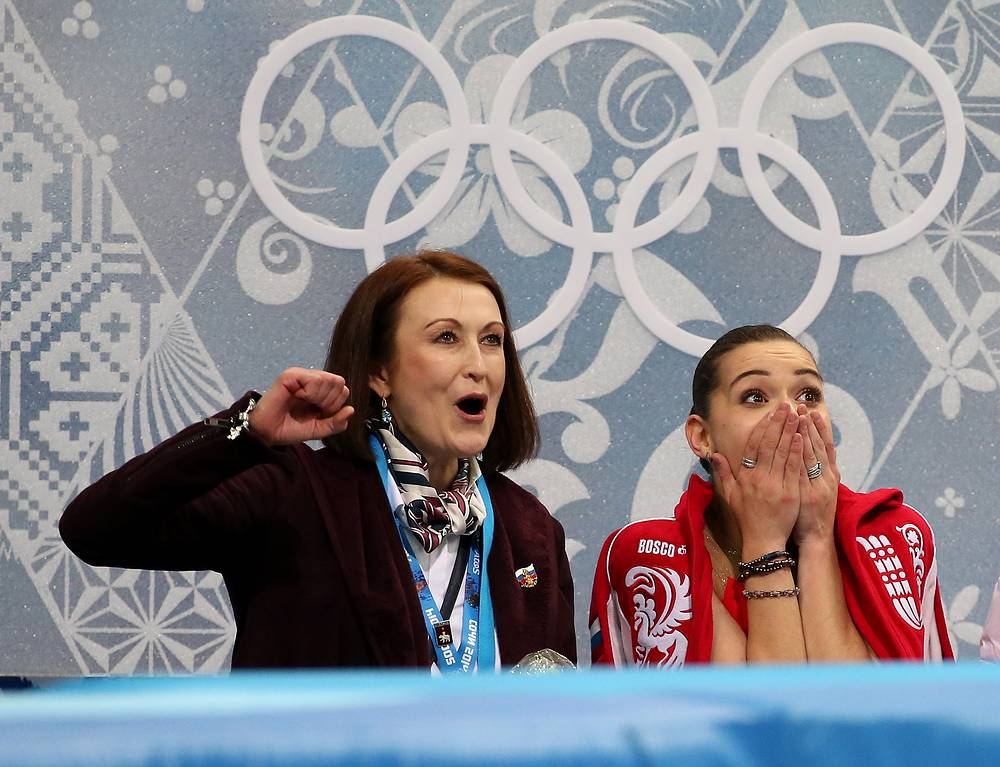 Russia's Adelina Sotnikova reacts seeing her score after short program