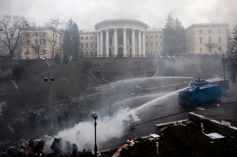 Riot police using water cannons against anti government demonstrators