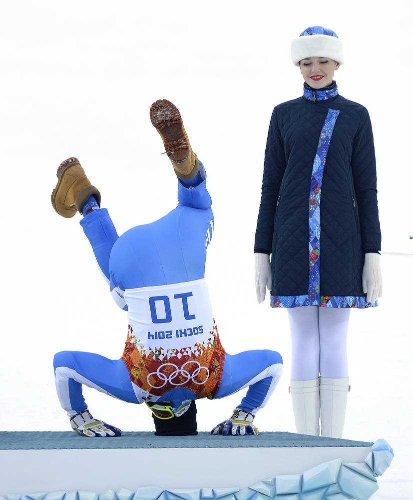 Some athletes need to cool down, whatever it may imply. Photo: Christof Innerhofer of Italy celebrates his bronze medal in Men's Super Combined competition