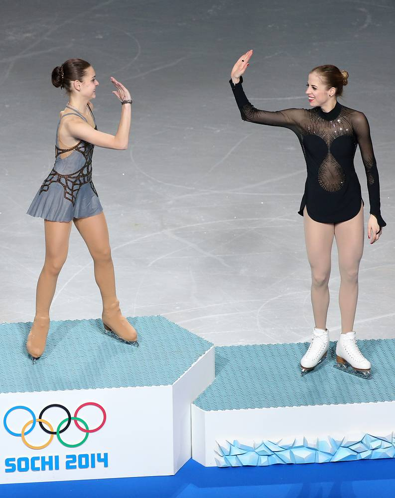 Or even high five. Photo: gold medalist Adelina Sotnikova (L) of Russia and bronze medalist Carolina Kostner of Italy