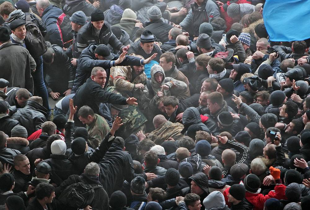Ukrainian and Russian supporters clash during a protest near the Parliament building in Simferopol, Crimea