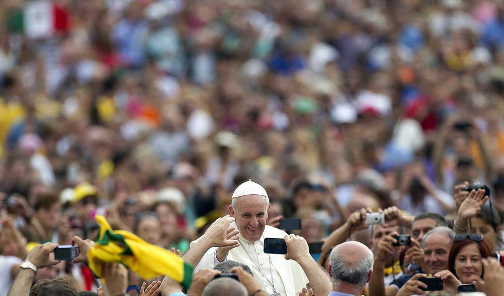 Pope Francis greets the crowd during audience in Saint Peter's Square