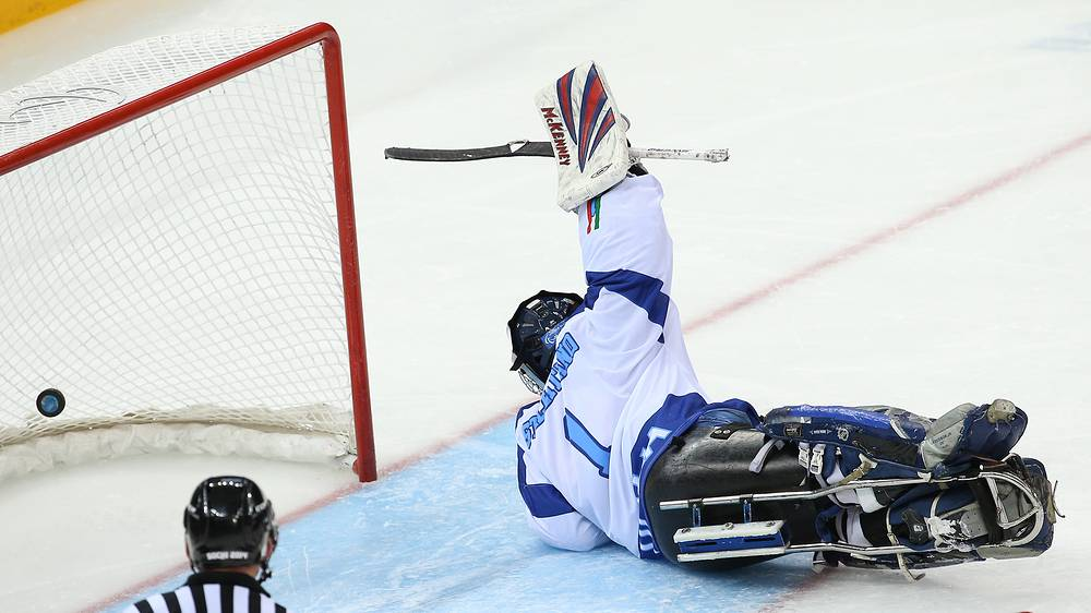 Italy's goalie Santino Stillitano missing a goal in an ice sledge hockey Preliminary round