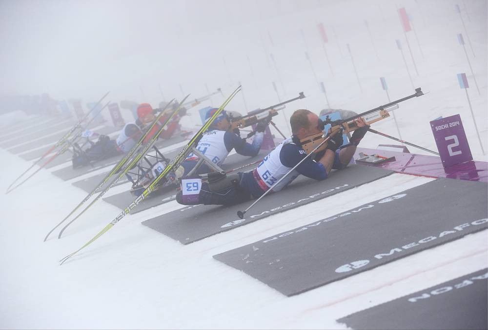 US Lieutenant Commander Dan Cnossen (63), US Army veteran Andy Soule (64), silver medalist Alexey Bychenok of Russia (66), R-L, compete in the Men's Biathlon 12.5km - Sitting