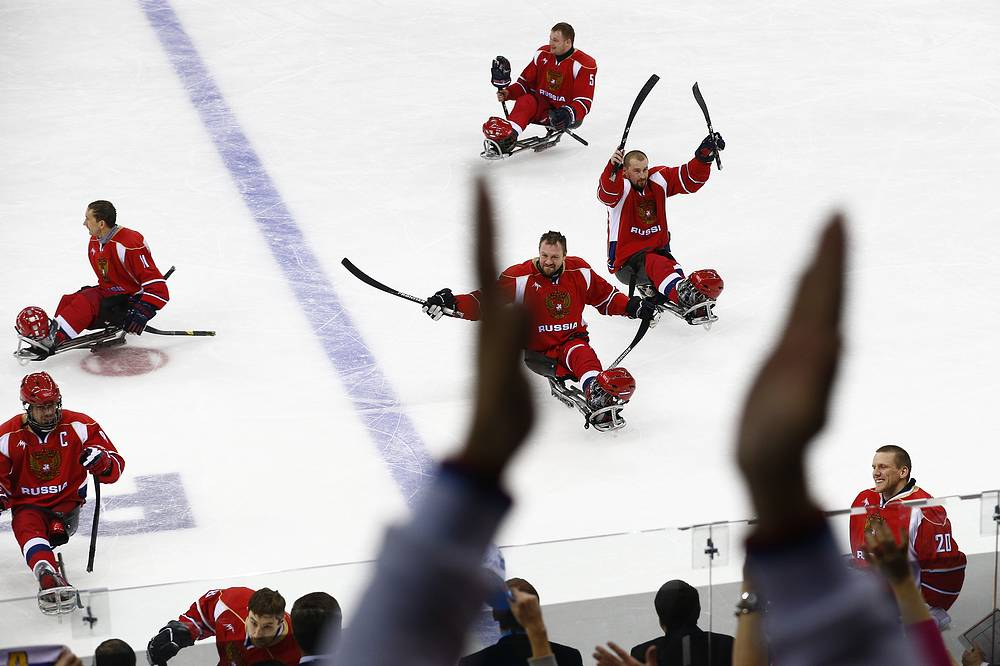 Russia players celebrate after winning the ice sledge hockey semifinal match against Norway