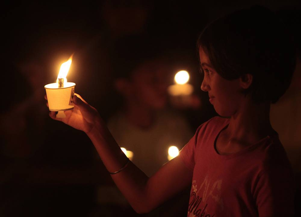 A girl holds a candle to mark the Earth Hour in India, 2011
