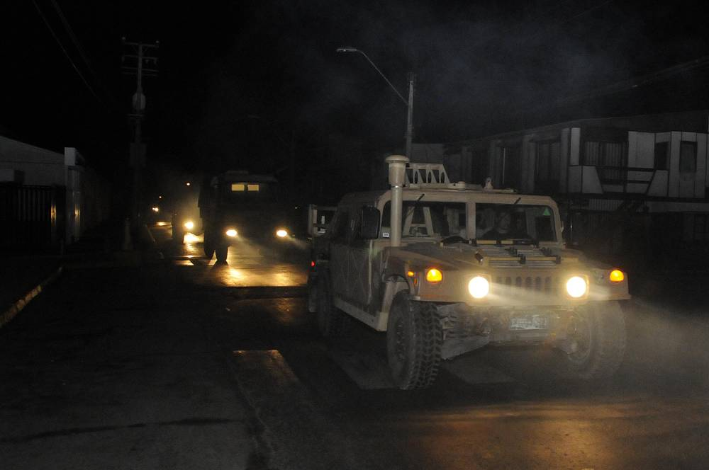 A military vehicle patrols after the earthquake