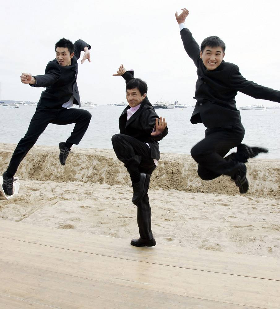 Jakie Chan often gets injured performing his stunts. That's why he's been put on black lists of most insuarance companies in the world. Photo: Jackie Chan, center, poses with Chinese actors Liu Fengchao, left, and Wang Wenjie