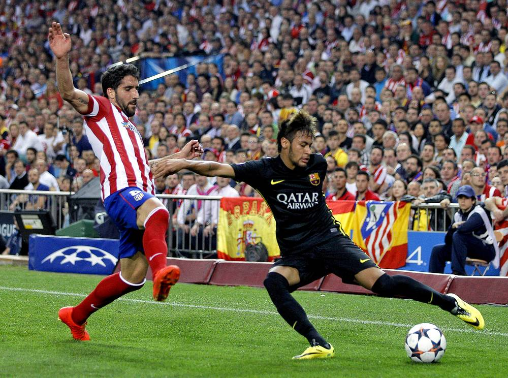 Atletico Madrid's midfielder Raul Garcia (L) in action against FC Barcelona's Brazilian striker Neymar (R)