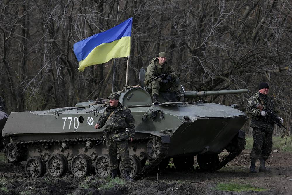 Ukrainian soldiers near their armed military vehicles not far from Izyum city, Kharkiv Region