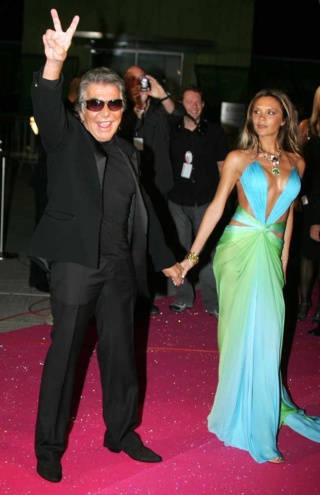 Victoria Beckham is a style icon. Photo: she and Roberto Cavalli in 2005
