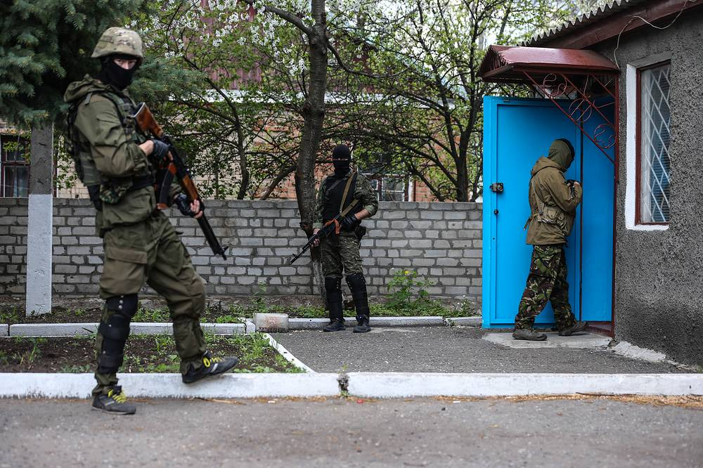 Members of self defense units near a police station in Nikolayevka