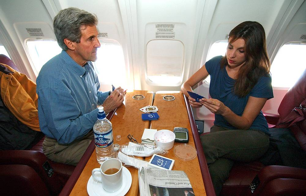 US Secretary of State John Kerry plays a game of cards with his daughter Alexandra aboard his campaign flight