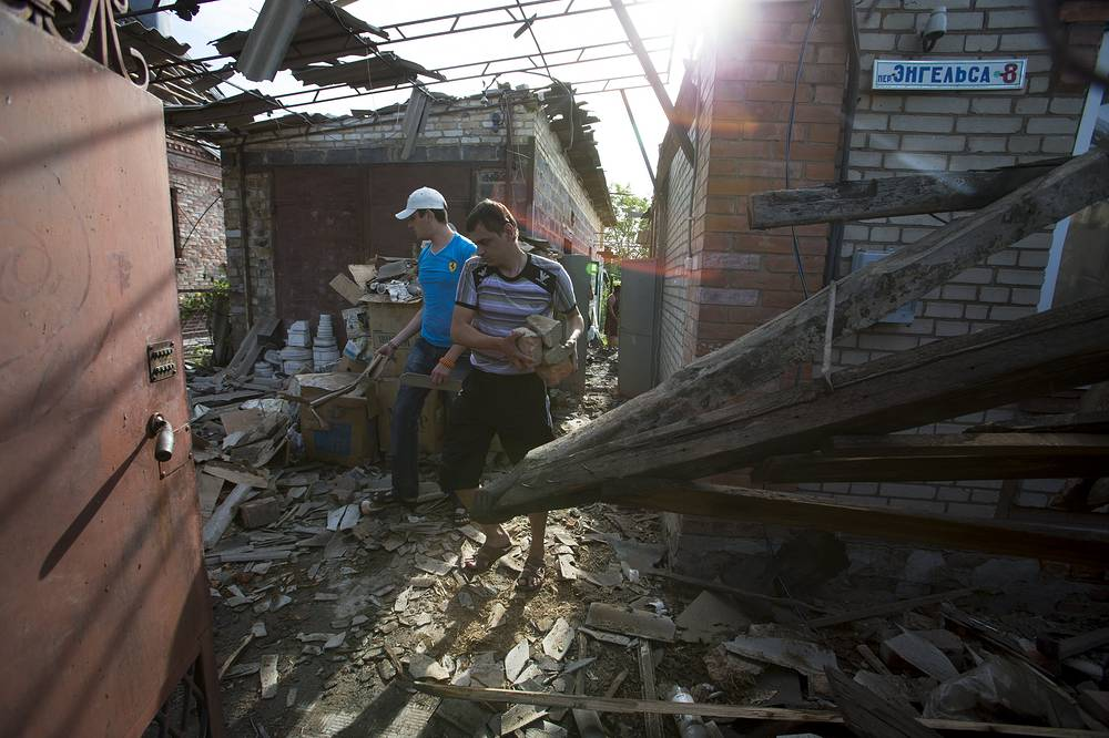 Local resident looks at the damage following shell explosions in Sloviansk