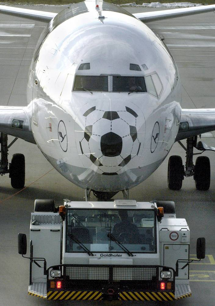 Boing 737 features a painted soccer ball on the bow