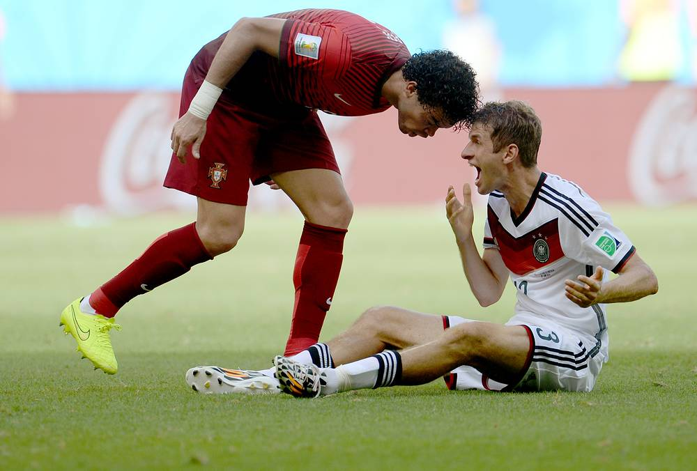 Pepe of Portugal (L) has a word with Thomas Mueller of Germany (R) during the FIFA World Cup 2014 group G preliminary round match between Germany and Portugal