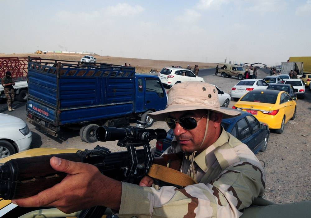 Armed men at a check point in Erbil