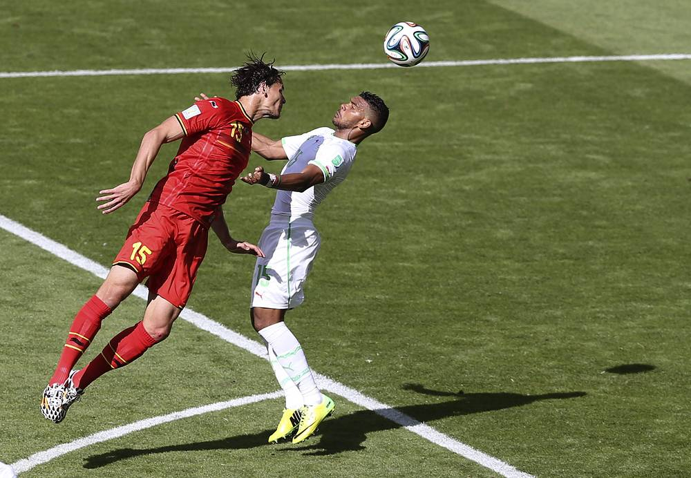 Daniel van Buyten of Belgium (L) and El Arabi Soudani of Algeria