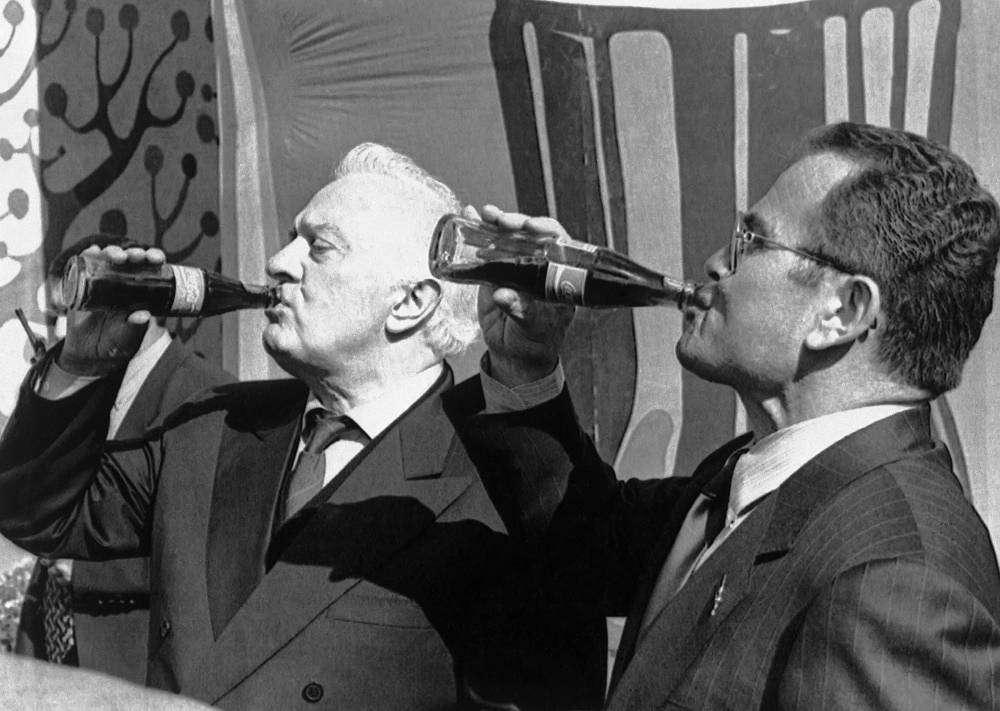 Eduard Shevardnadze (left) and president of Coca-Cola Bottlers Georgia Temur Chkonia in Georgia, 1997