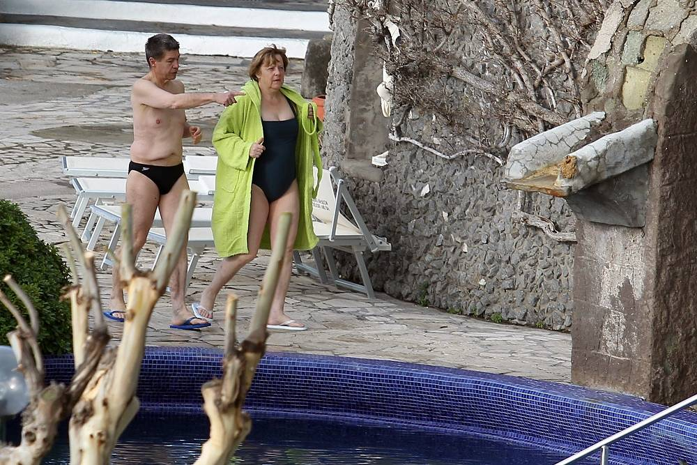 German Chancellor Angela Merkel and her husband Joachim Sauer walk in the thermal baths of Sant'Angelo d'Ischia, southern Italy, 2013