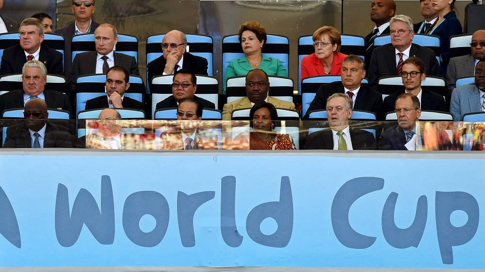 IOC President Thomas Bacj, Vladimir Putin, FIFA President Sepp Blatter, Brazil's President Dilma Rousseff, German Chancellor Angela Merkel and German President Joachim Gauck watch the World Cup final