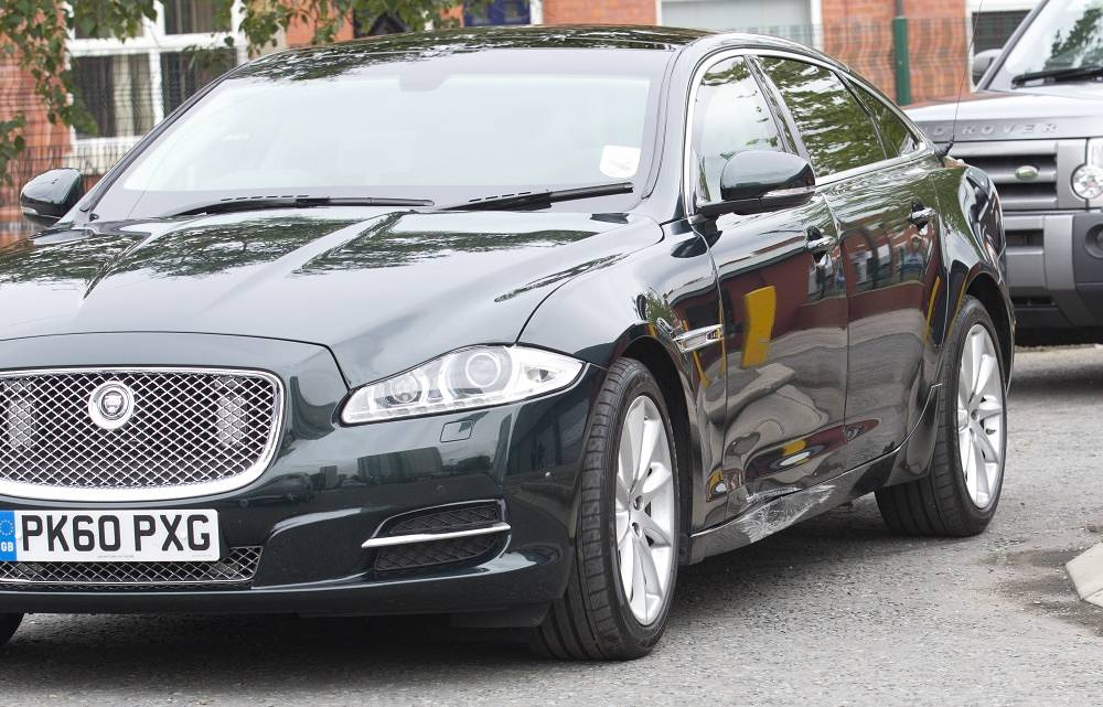 British Prime Minister David Cameron uses a Jaguar XJ X351. Photo: Cameron's car damaged in a road accident