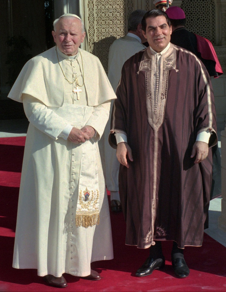 Pope John Paul II poses with Tunisia President Zine Abedine El Ben Ali, who wears the traditional Tunisian djeba dress